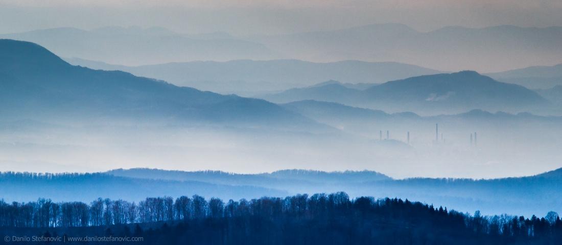 Lost in Haze - Factory Viskoza Loznica chimneys mountain landscape